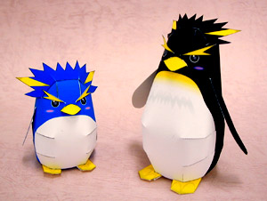 Papercraft de dos pingüinos infantiles. Manualidades a Raudales.